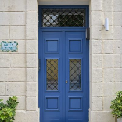 Blue wood main door.
